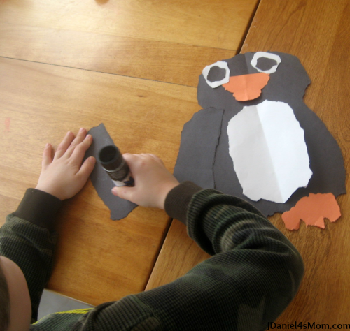Penguin Craft - Torn Paper Penguin : Putting the penguin's wings together.