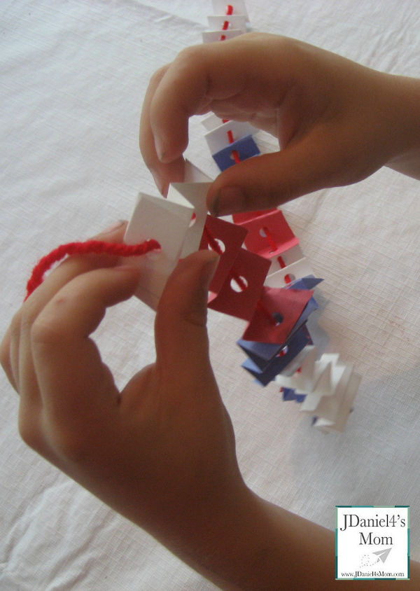 Fine Motor Activity- Fold and Thread Necklace
