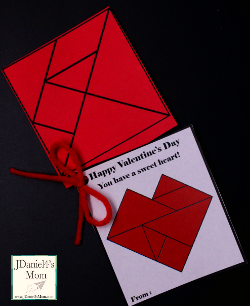 Heart Tangram Printable Valentine Cards- These fun cards give  kids a non-candy treat to give their friends. The tangram shapes attached to the card can be used to build the heart on the card and hundreds of other patterns.