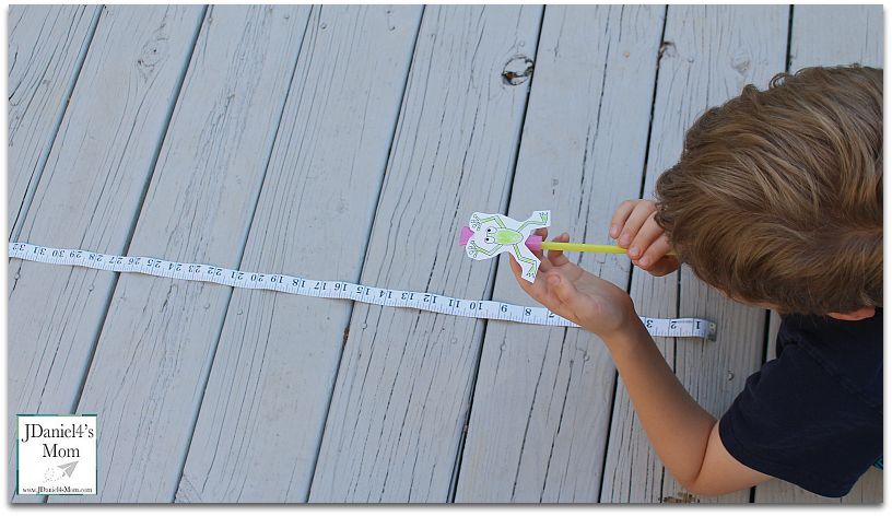Leap Frog Straw Rocket with Printable - Blowing the Frog Down the Measuring Tape
