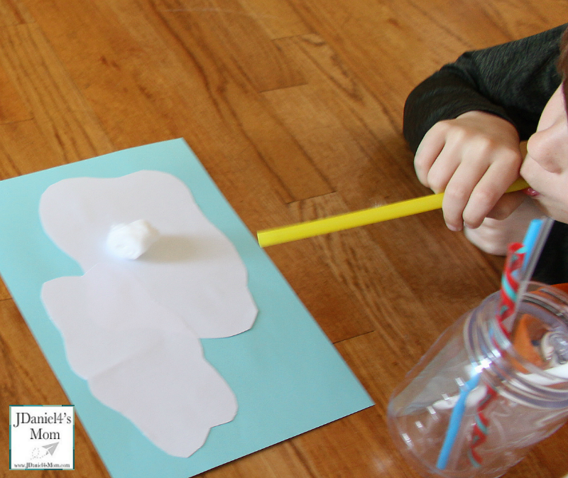 Sensory Activity- Blowing Clouds with a Straw: Blowing a cotton ball from cloud to cloud.