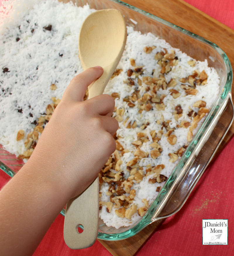 TEM Sedimentary Rock Cookie Recipe and Activity for Kids - Finally use a wooden spoon to compress the layers.