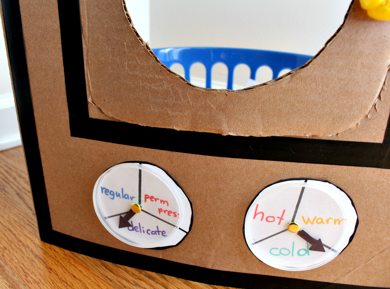 A DIY Cardboard Kids' Washing Machine - It is great for pretend play or a part of a learning activity for kids. It has movable dials.