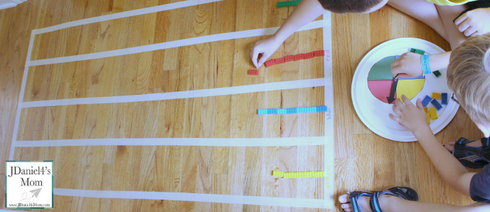 Let's Create a Graph on the Floor and Gather Data- A printable spinner,LEGO and tape graph are a great way to explore collecting data and displaying it.