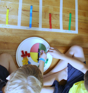 How to Create a Graph with Tape- A printable spinner,LEGO and tape graph are a great way to explore collecting data and displaying it.