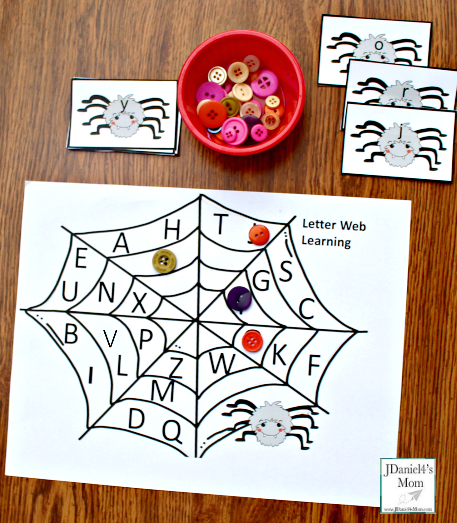 Alphabet Match Game with a Spider Theme - This is a free printable set includes spider letter cards and letter web.