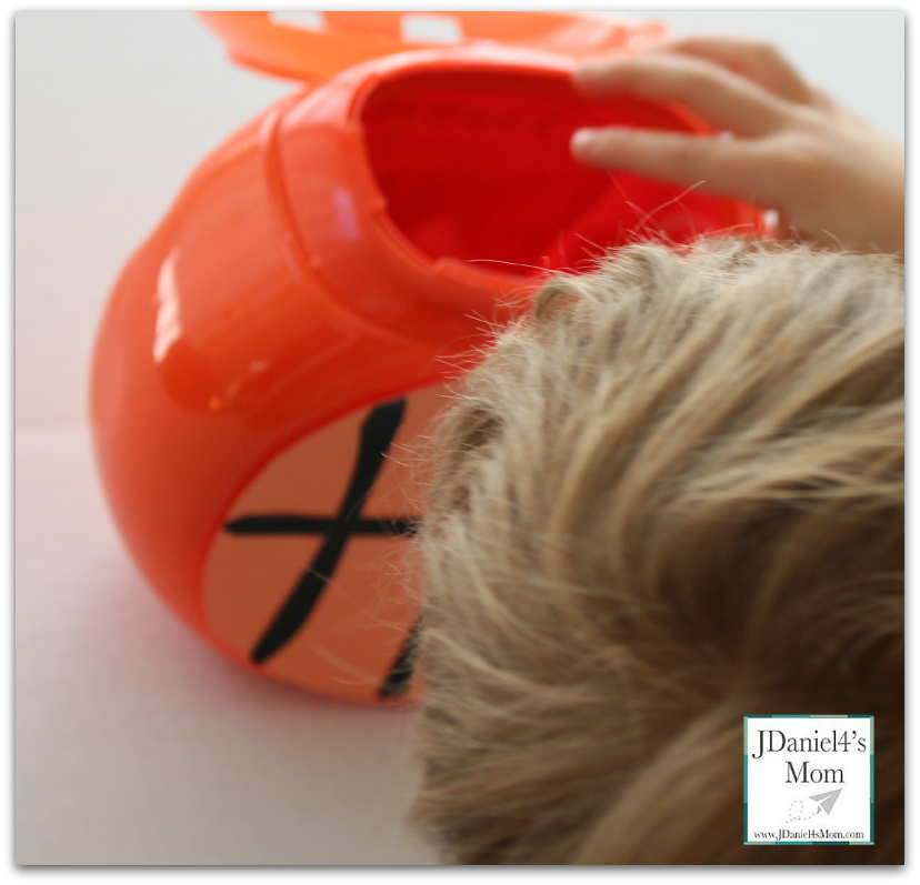 Slam Dunk- Fun Math Games : Game made from an old detergent container.