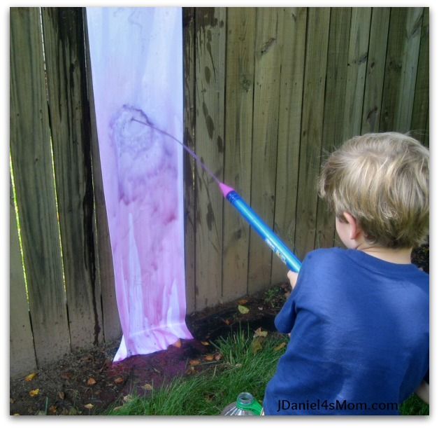 jdaniel4smom_red_white_boom_water_gun_painting_blue