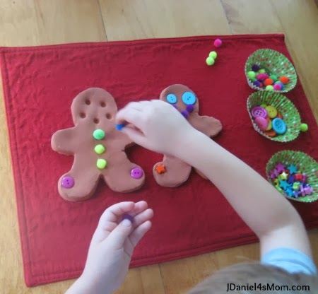 Decorating-gingerbread-men-with-stars