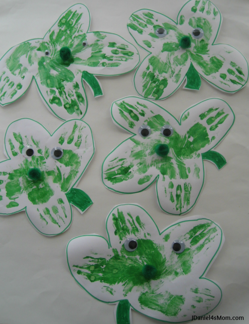 Five Hand Print Shamrocks with Eyes and Noses