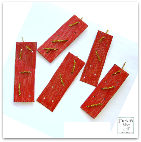 Five Little Firecrackers Craft and Song - This fine motor activity would be great to do for any patriotic holiday like the 4th of July. Kids can weave their own designs on the cardboard fire cracker they paint. Then they can use the to retell this fun rhyme.