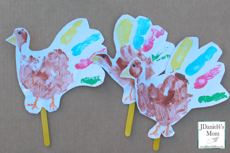 Five Little Turkeys Stick Puppets and Song- Children's hand prints make fun turkey puppets to use while sing the song Five Little Turkeys .