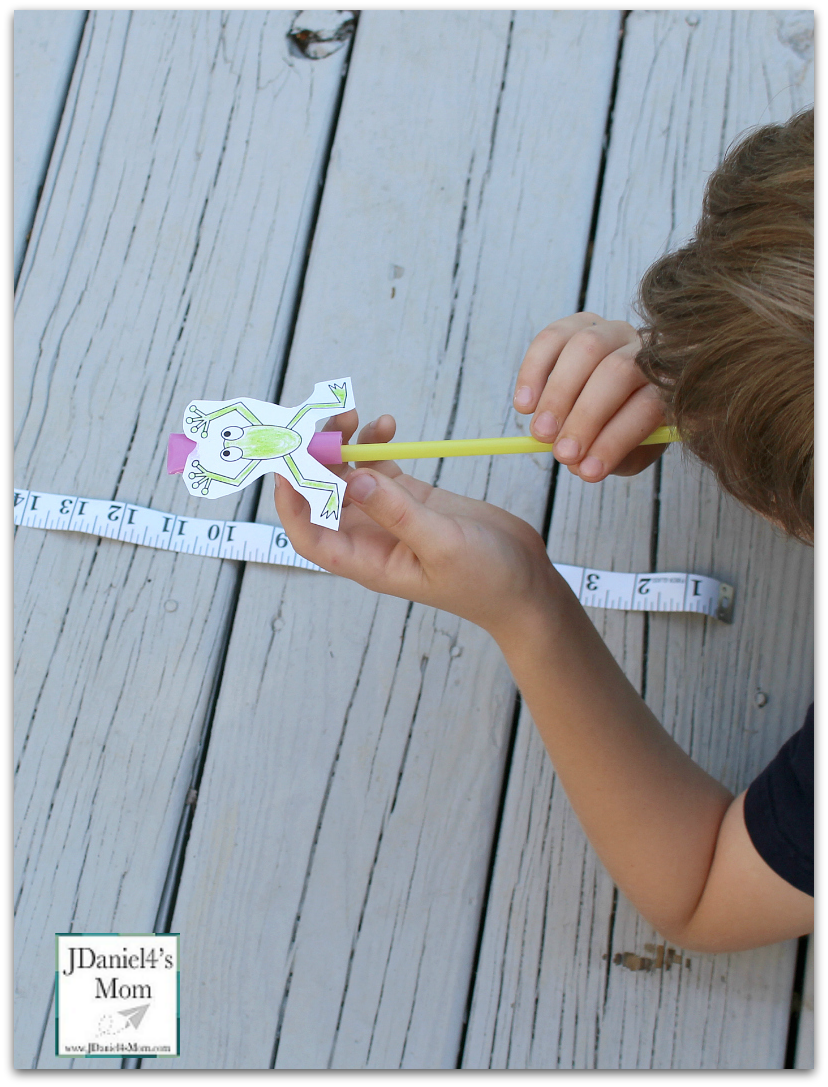 Leap Frog Straw Rocket with Printable- Ready to Blow the Rocket- Kids will have fun with this STEM activity. They have to work out how to make the frog leap farther and farther.