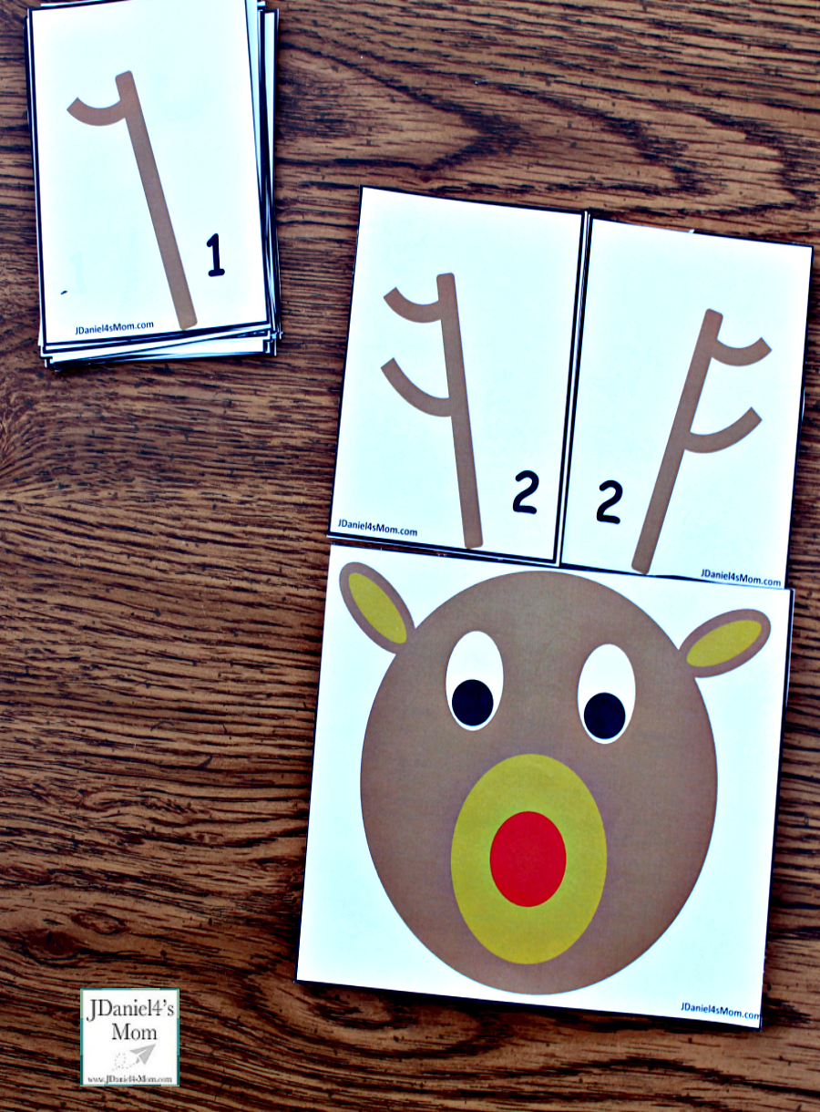 Reindeer Antlers Number Recongition - Students at school or children at home can work on number recognition and counting skills using this free printable set. It includes reindeer counting heads and ten pairs of antlers. Each anter card displays a number in antler points and number form. Children will have fun changing the number o antlers on their reindeer. This pair explores the number 2.