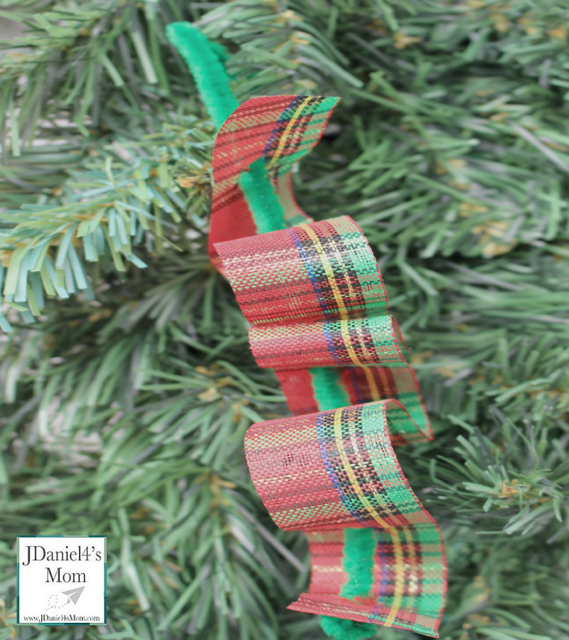 Ribbon Candy Homemade Ornament- Fun fine motor craft for kids. They will have fun weaving pretty holiday ribbons through pipe cleaners.