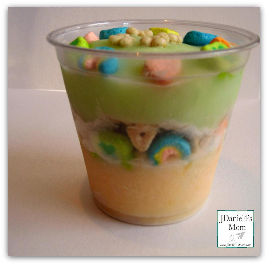 St. Patrick's day breakfast idea using orange creamsicle, keylime pie yogurt, and lucky charms.