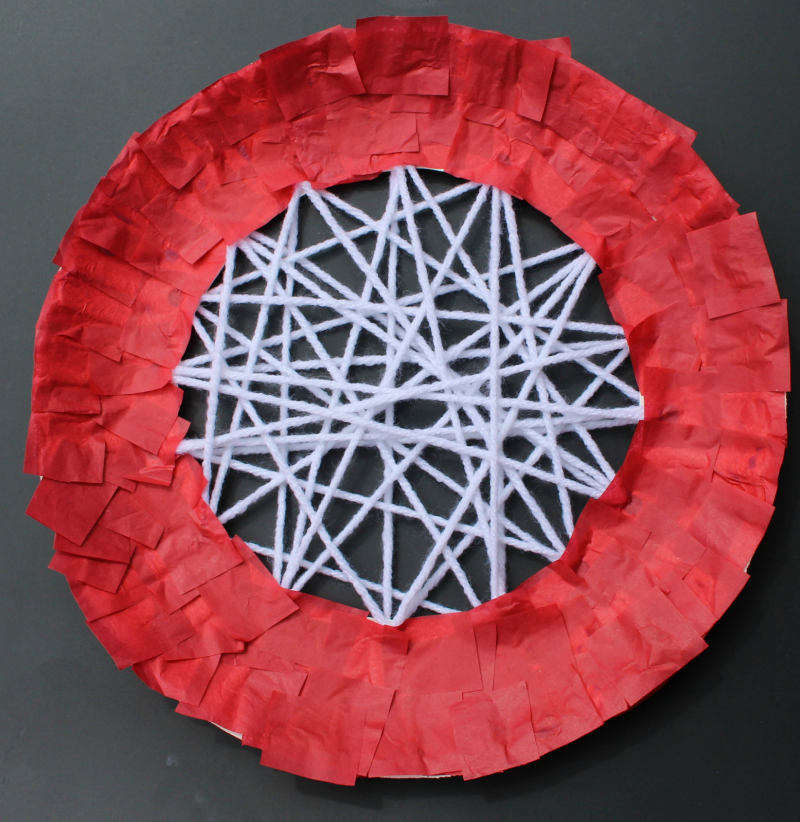 Apple Craft That Works on Fine Motor Skills - Adding Red Tissue
