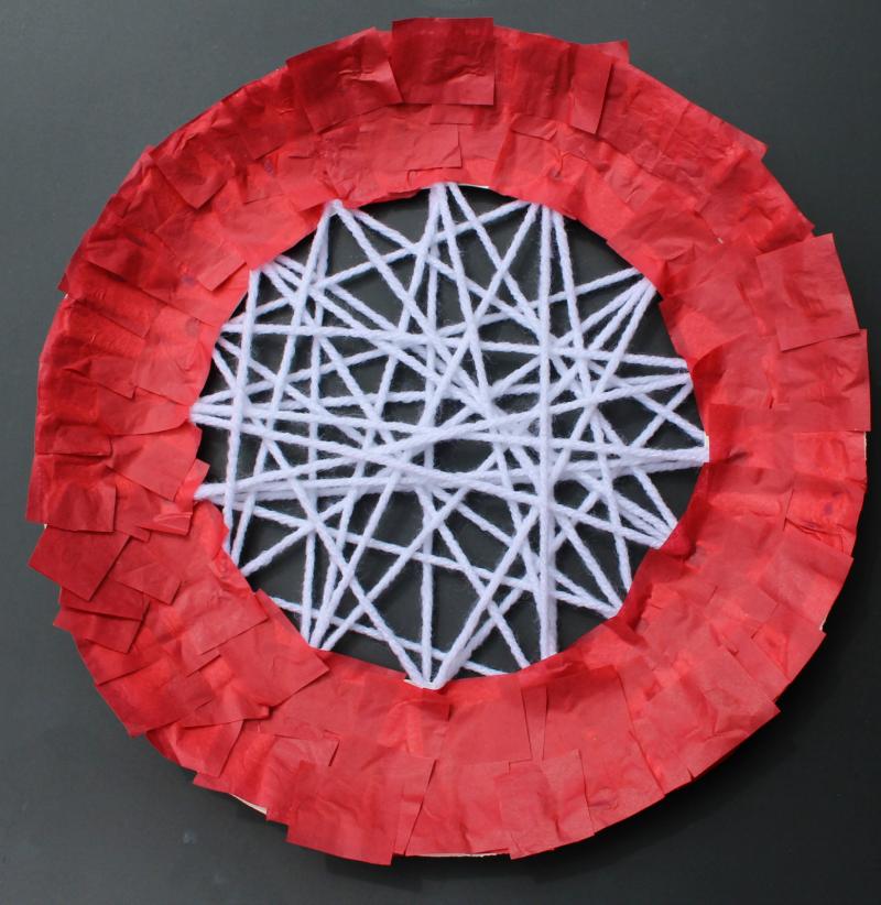 Apple Craft That Works on Fine Motor Skills - Adding Red Tissue
