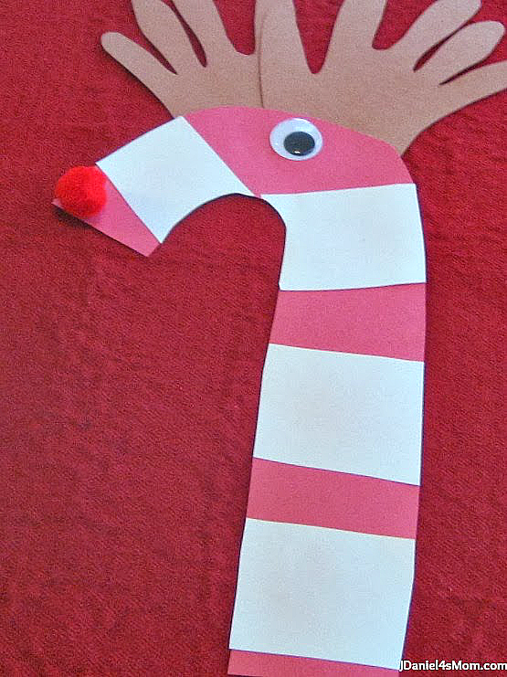 Christmas Craft- Candy Can Reindeer: Kids will love having their hands become reindeer antlers.