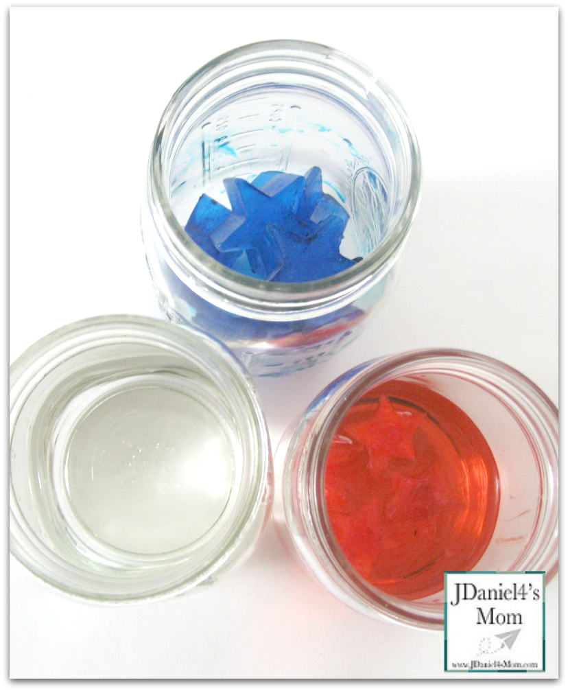 These easy experiments look at how much water will end up in a jar. Students will start with ice stars. ice stars in water and a glass of water. Once the ice melts students can measure the results. We used red, blue and clear water to do this experiment. It was near the 4th of July.