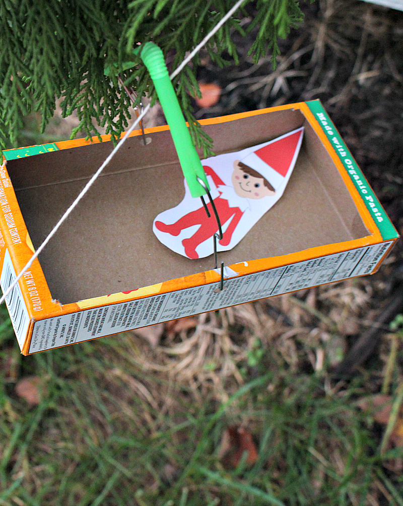 Elf on the Shelf Zip Line STEM Challenge - The Elf on the Shelf in his zip line carriage.