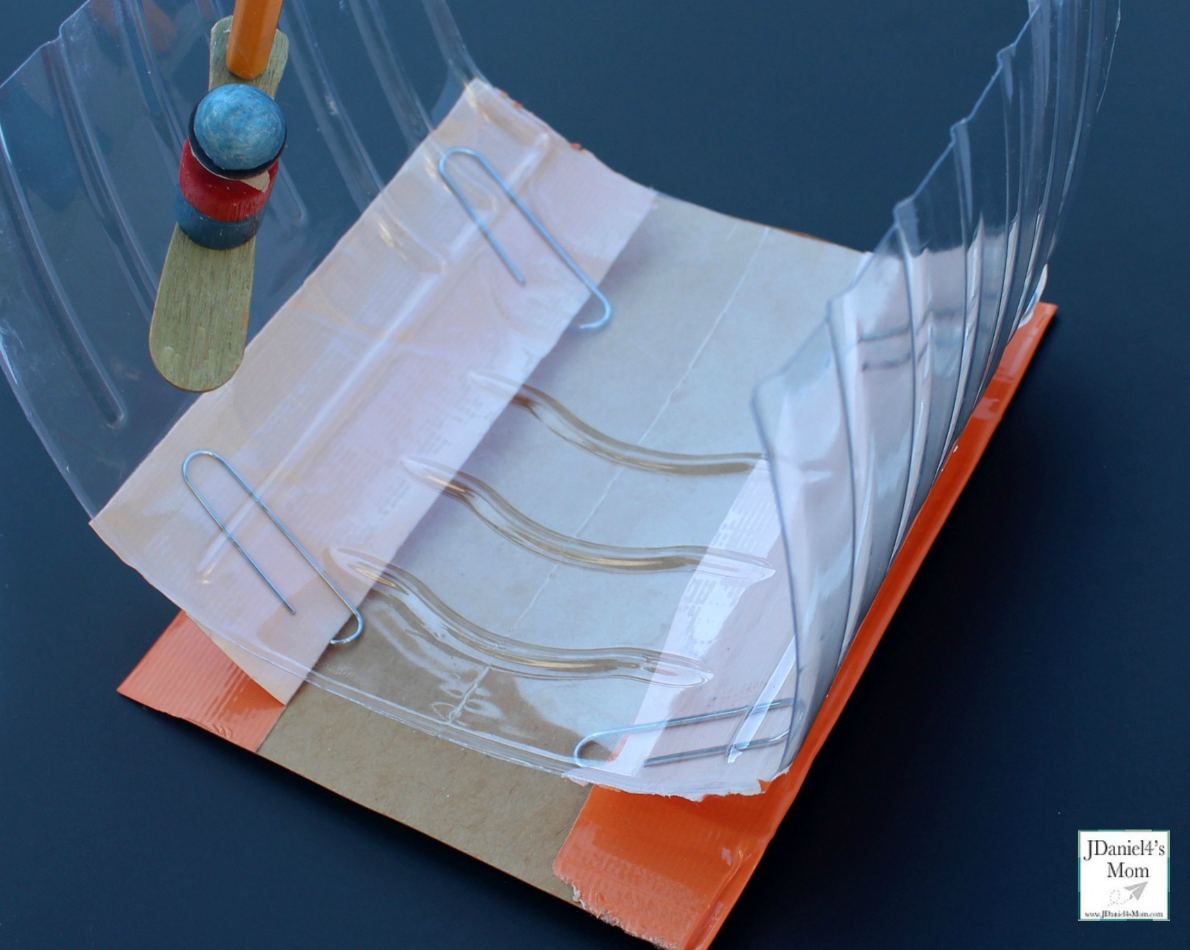 Winter Olympic Sports - STEM Snowboarding Halfpipe : This is a fun STEM activity that can be used for creative play. This view is of the paper clips duct taped down.