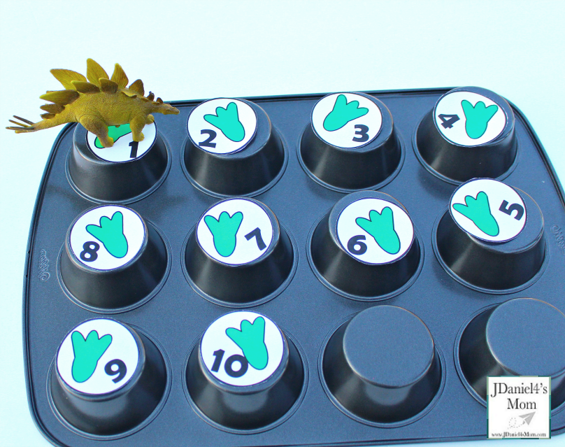Dinosaur Activities for Kids That Explore Numbers - This printable set of numbers can be used in or on top of a muffin tin find numbers or create a number path.