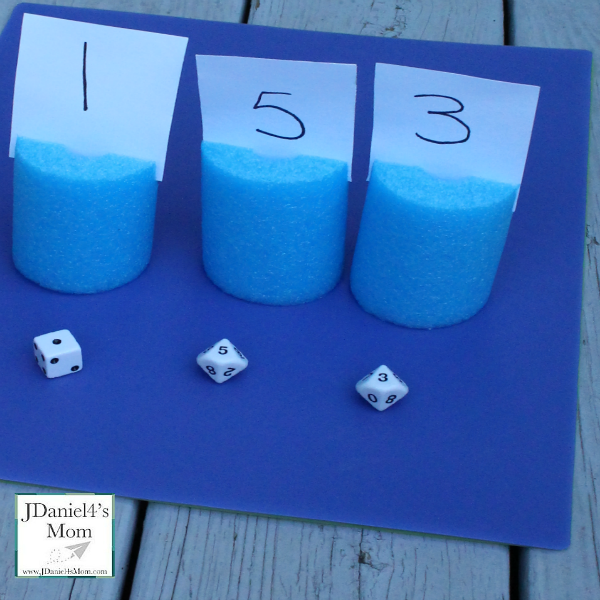 Place Value Games Played with Pool Noodle Place Cards - These games focus on building one, two and three digit numbers.