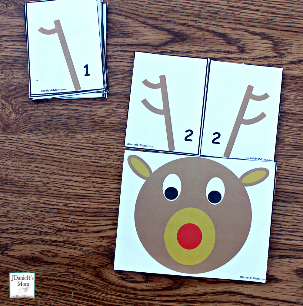 Reindeer Antlers Number Recongition - Students at school or children at home can work on number recognition and counting skills using this free printable set. It includes reindeer counting heads and ten pairs of antlers. Each anter card displays a number in antler points and number form. Children will have fun changing the number o antlers on their reindeer. This pair explores the number two.