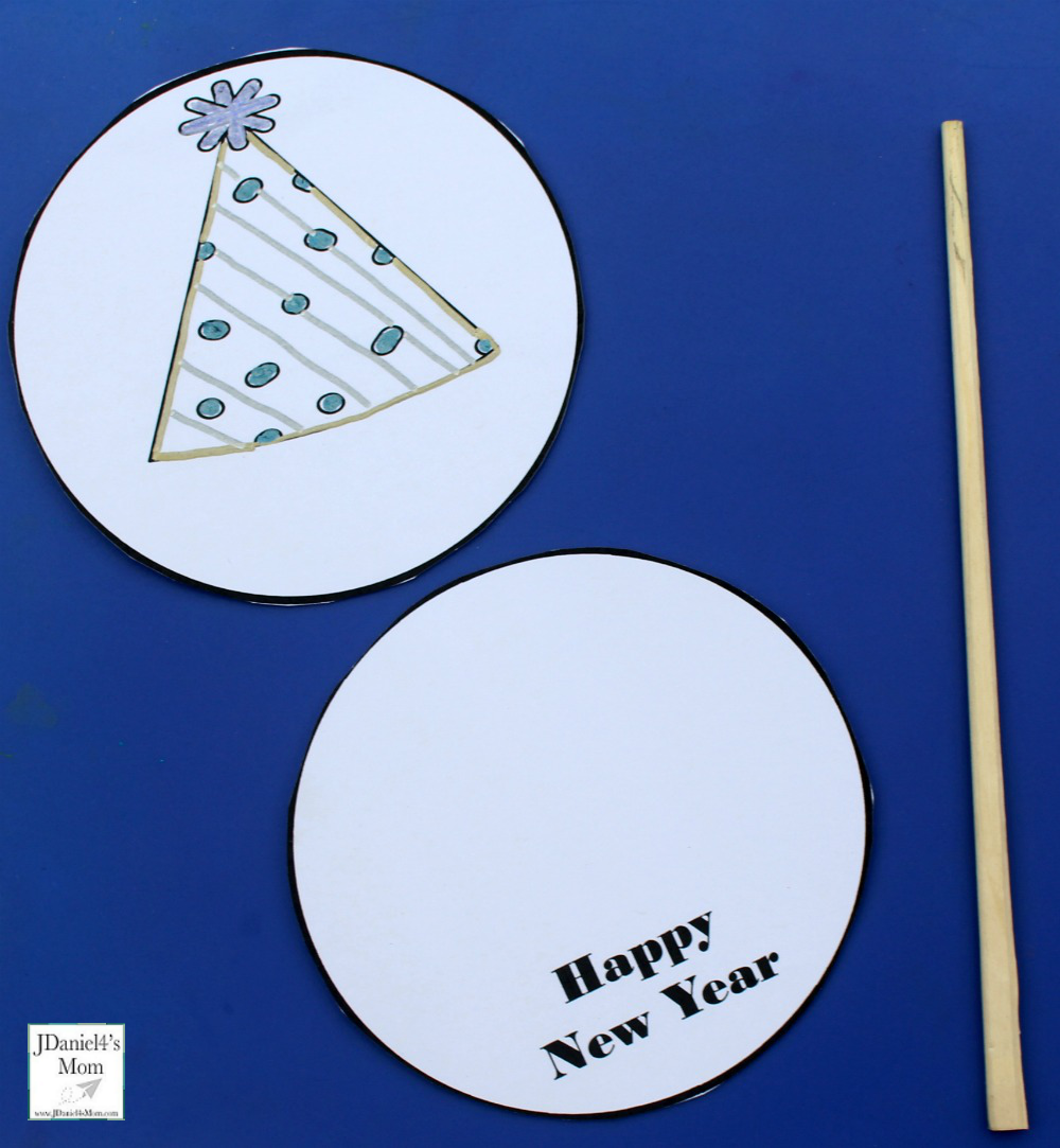 New Year's Thaumatrope Printable Set - Children at home and students at school can select from four designs for their thaumatrope. Here are the supplies you are going to need.